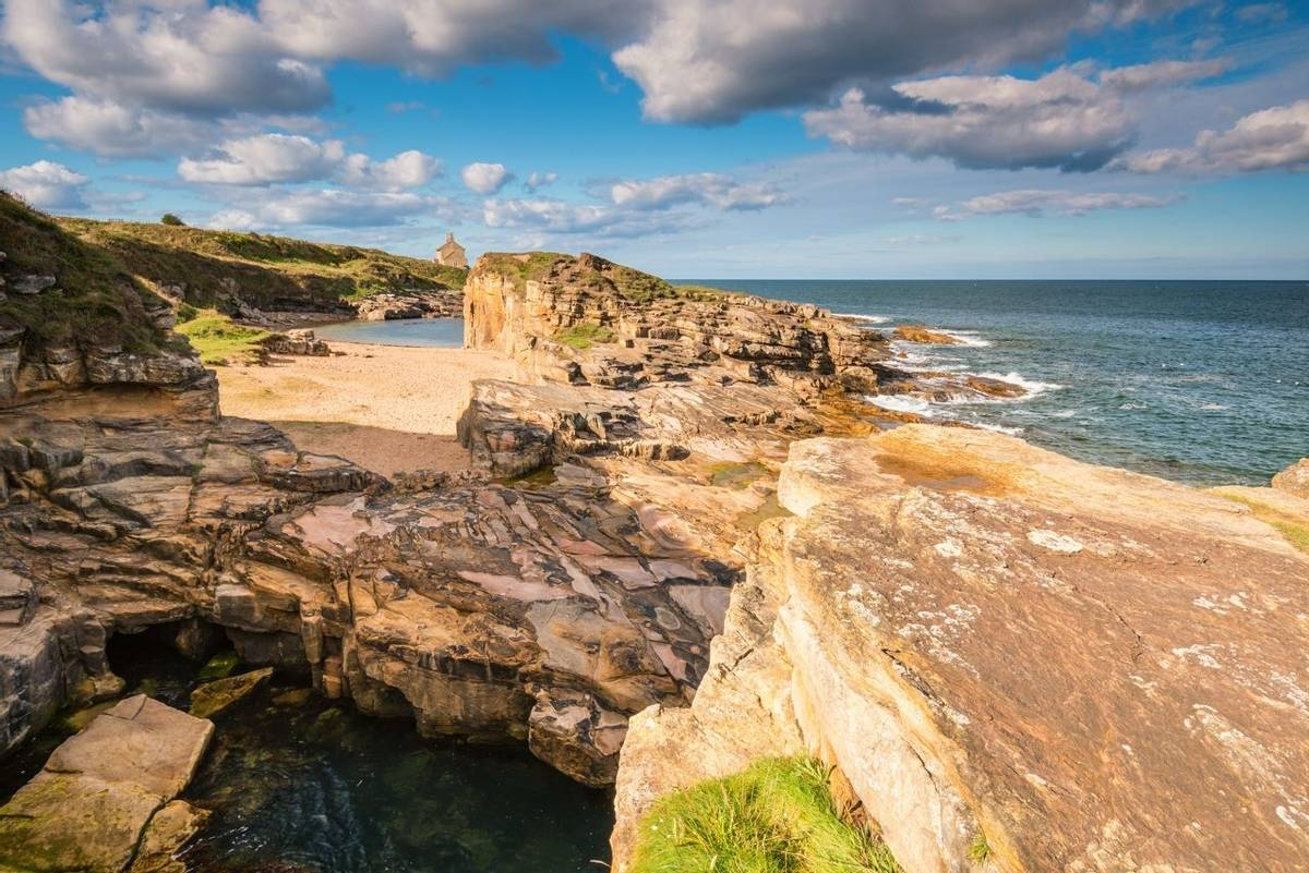 At Rumbling Kern near Howick on the Northumberland coastline lies a small beach and cove, sheltered by small cliffs