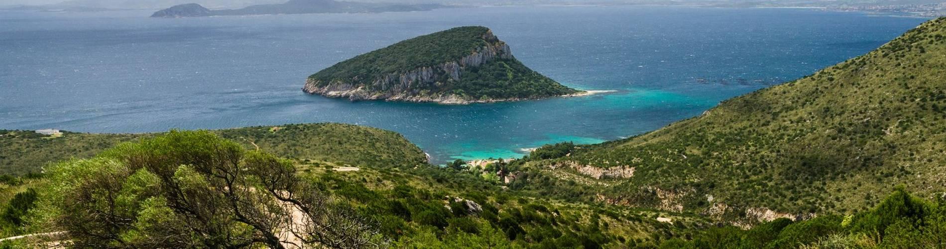 Panoramic view of Capo Figari and Figarolo island. People hiking.