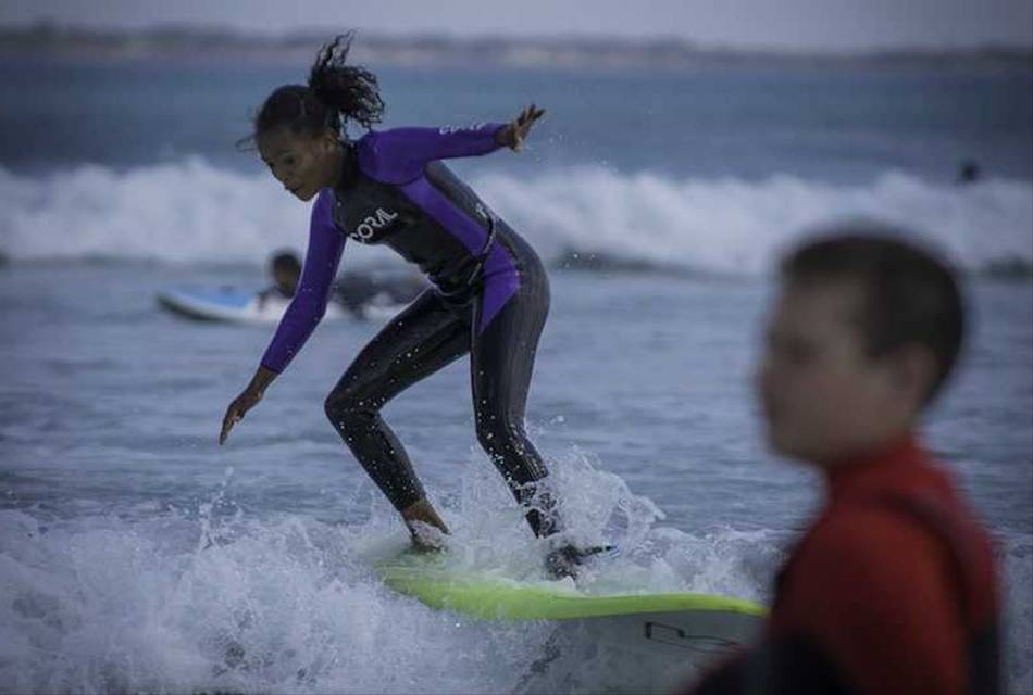 Adventure surf club project - one of the particpants learning to surf