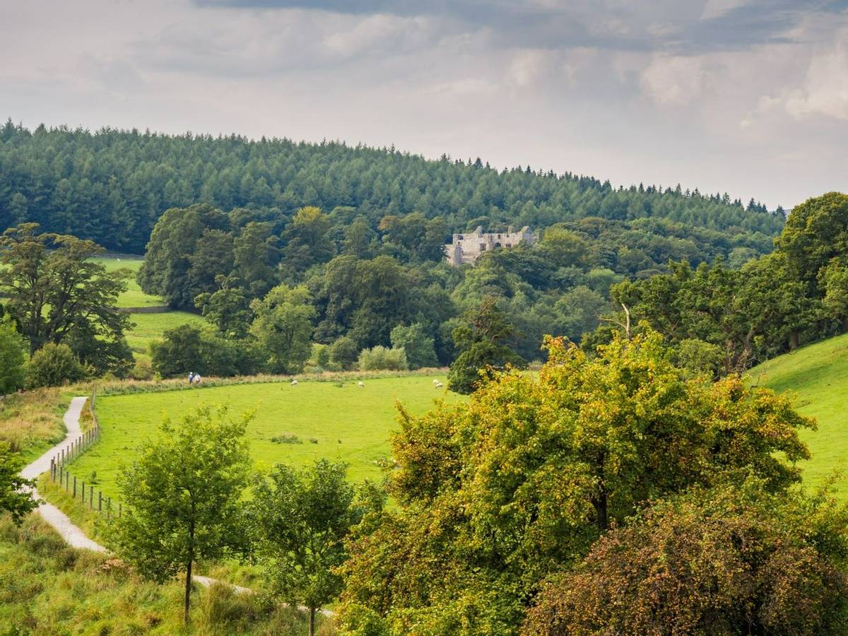 View of the river Wharfe and Barden Tower at Bolton-le-sands, Skipton, Yorkshire, UK