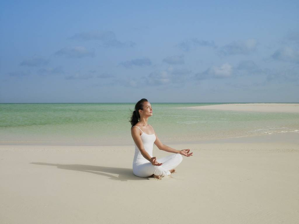 Yoga on the beach at Parrot Cay