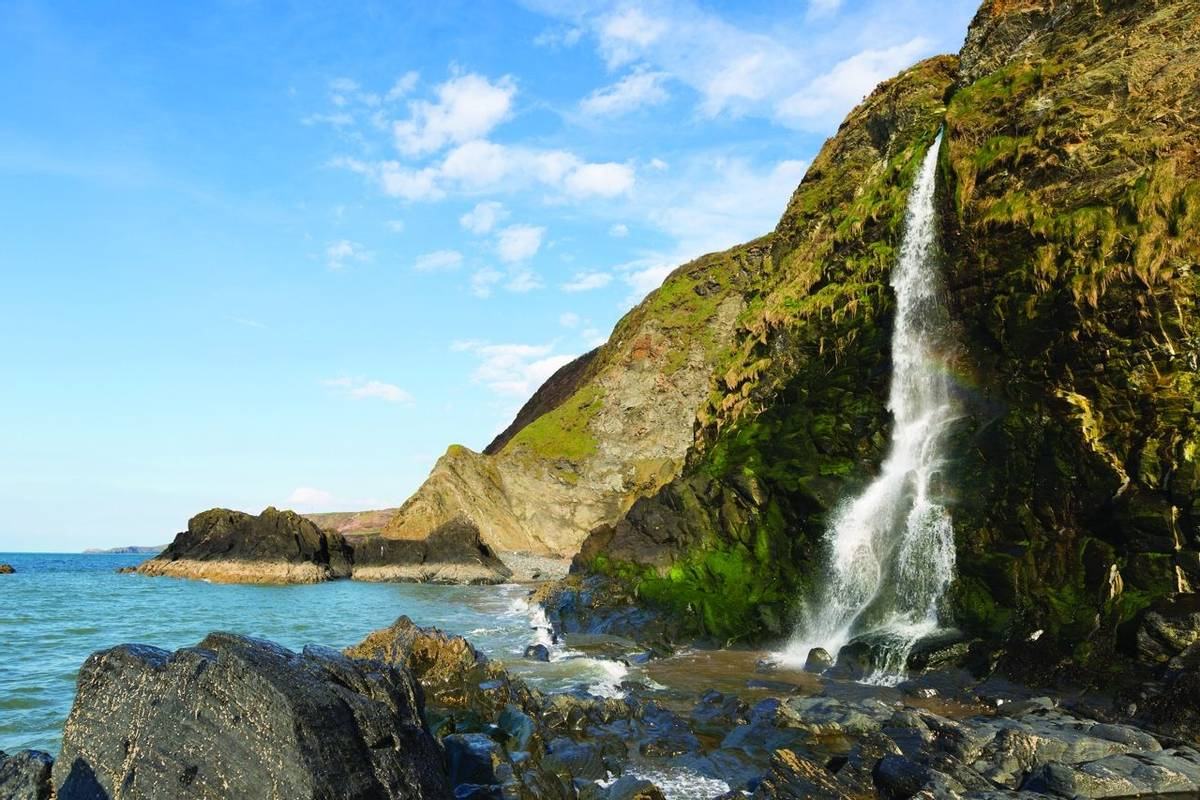 Waterfall at Tresaith Beach, Cardigan Bay, Wales.