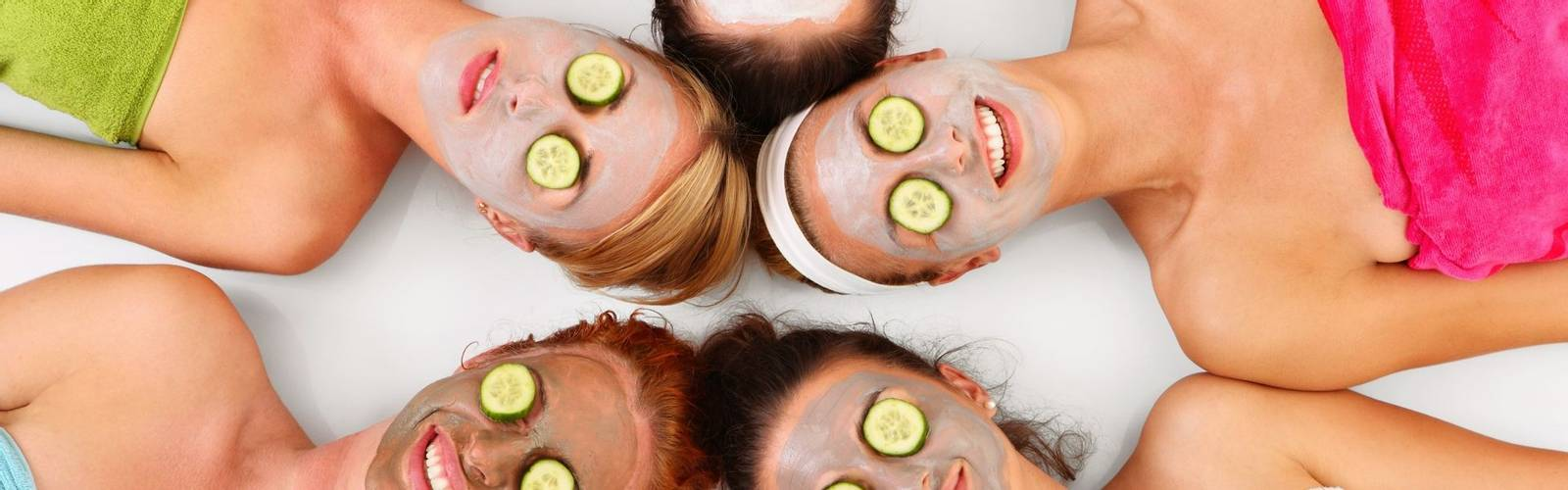 16537352 - a picture of five girl friends relaxing with facial masks on over white background