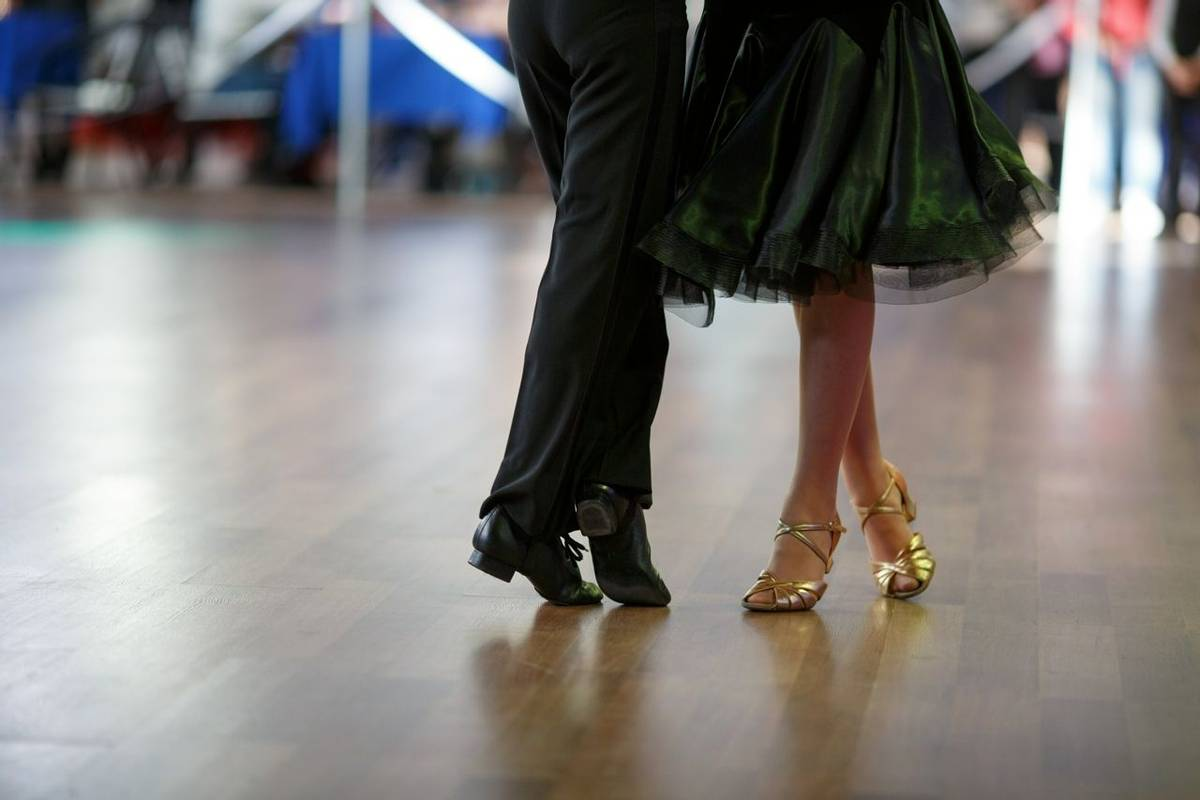 Closeup of dancer's legs as they do the ballroom dance