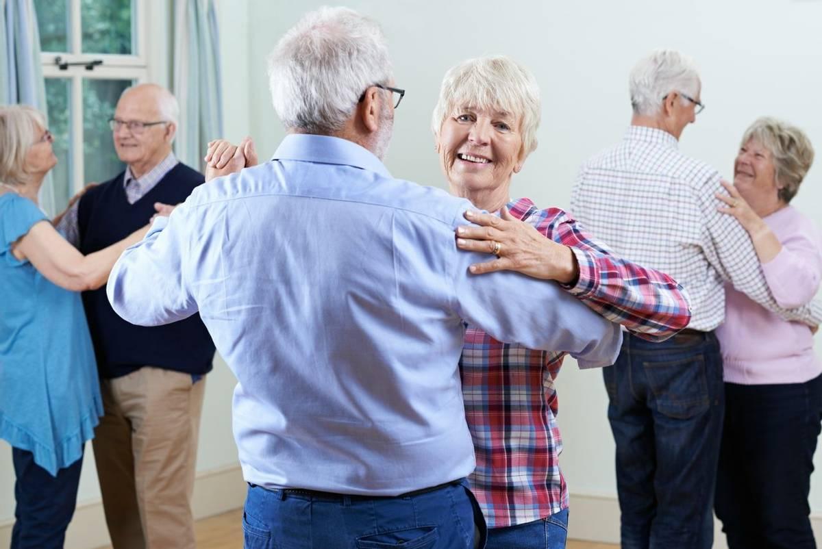 Group Of Seniors Enjoying Dancing Club Together