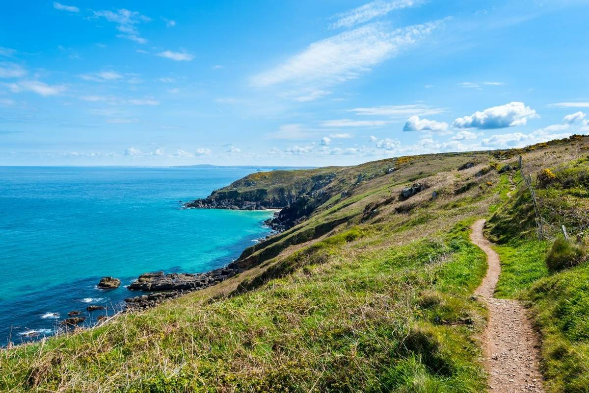 North Cornwall Coast near St Ives. Looking east along the coast path towards Pen Enys Point and Polgassick Cove.
