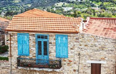 Typical stone house with a tiled roof in a Cypriot village