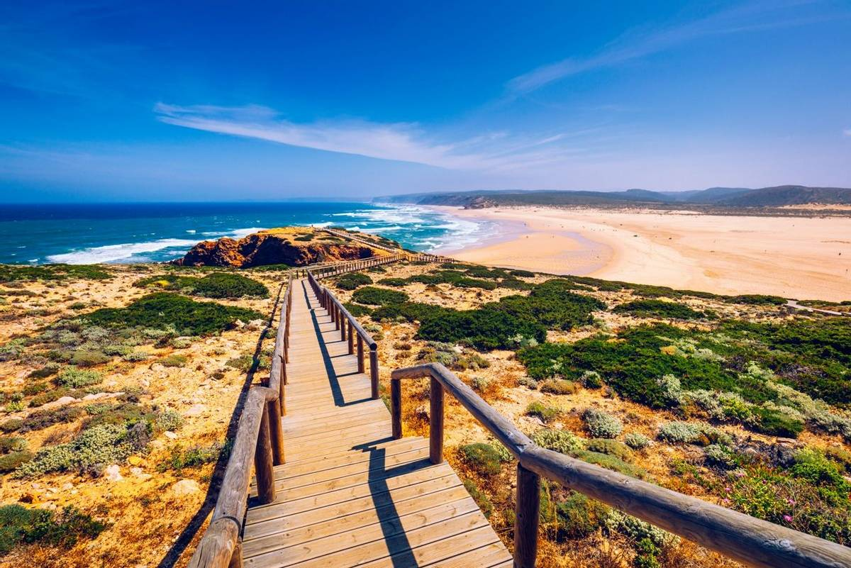 Praia da Bordeira and boardwalks forming part of the trail of tides or Pontal da Carrapateira walk in Portugal. Amazing view…