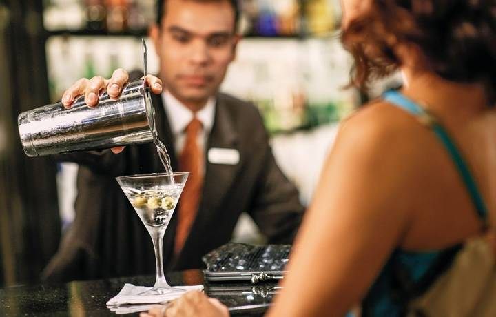 A bartender serving a cocktail at Dolce Vita.
