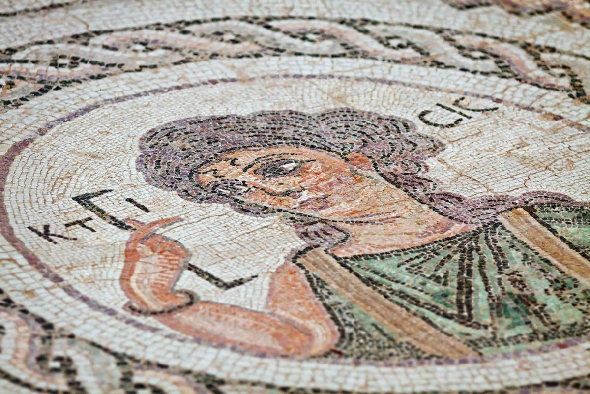 Close-up fragment of ancient religious mosaic in Kourion, Cyprus