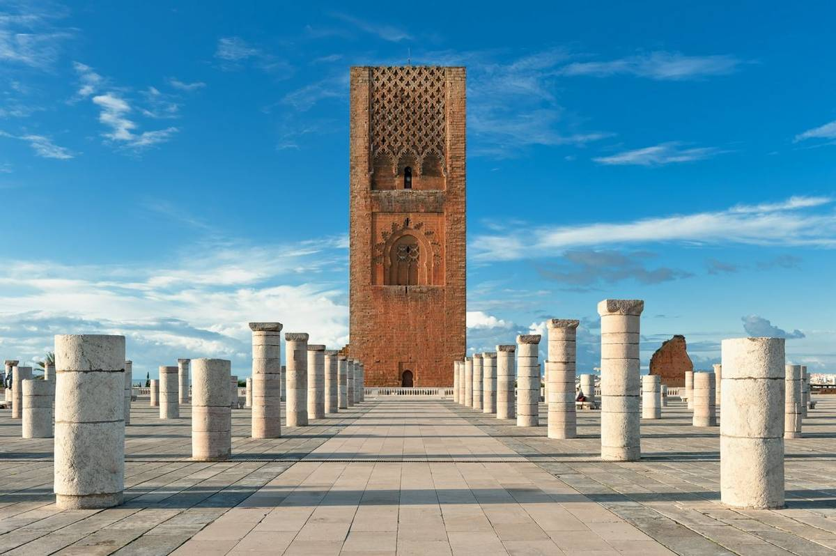 Tour Hassan tower in the square with stone columns. Made of red sandstone, important historical and tourist complex in Rabat…