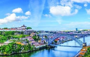 View of the historic city of Porto, Portugal with the Dom Luis bridge and blue sky / Panoramic view from the city of Porto i…