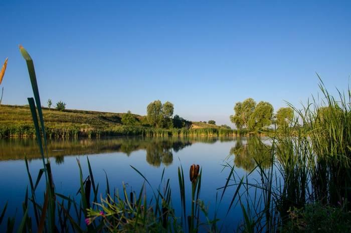 Countryside lake, France shutterstock_689209408.jpg