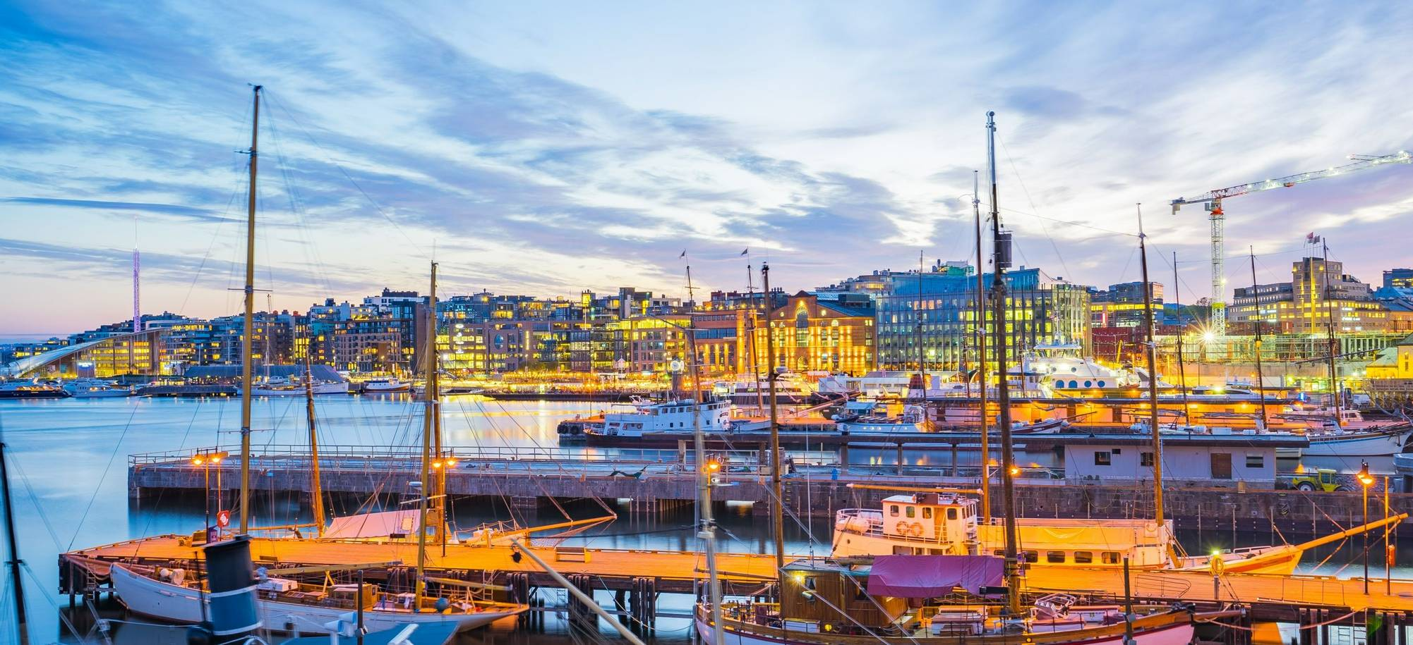 Oslo city, Oslo port with boats and yachts at twilight in Norway.