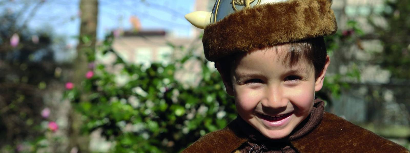 happy little kid with a Viking costume in carnival