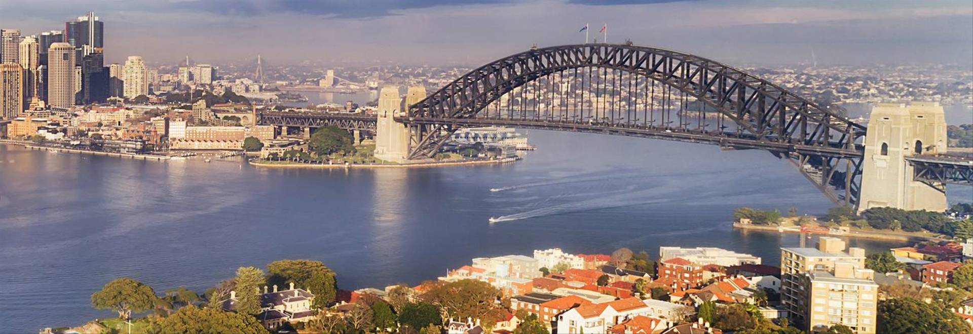 Quiet still earlier morning gentle sun light over Sydney city main landmarks around Harbour waters and shores between CBD an…