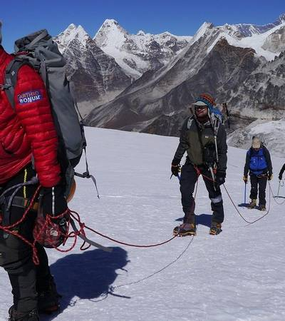 Climbing as a rope group on Mera Peak