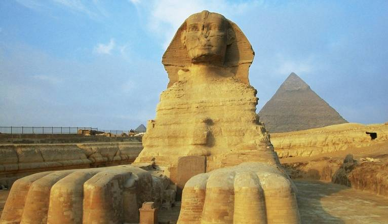 GettyImages 56806455 Sphinx In Front Of Pyramids, Giza, Cairo