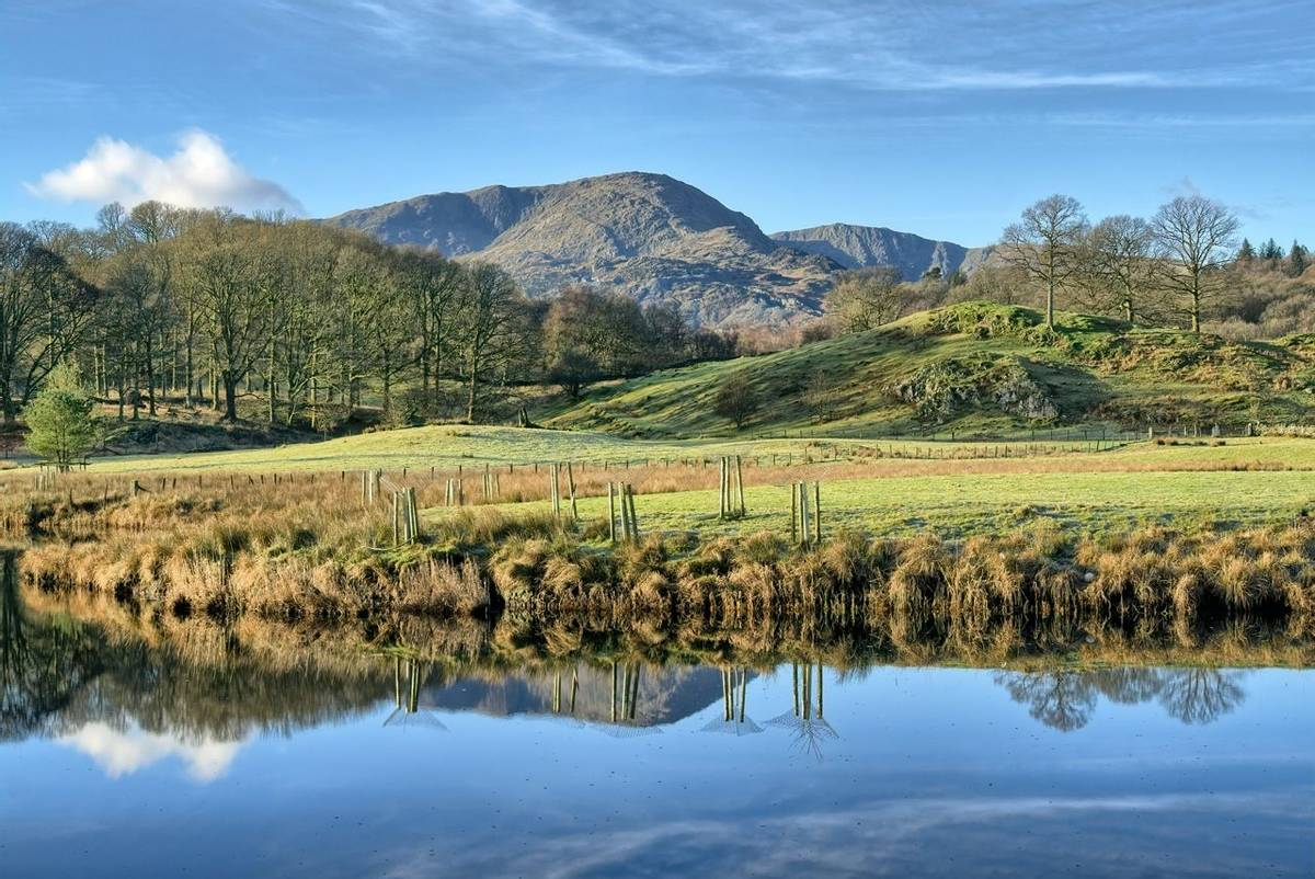A view of Wetherlam, a mountain in the English lake District across Elterwater. Great Langdale, the English Lake District.