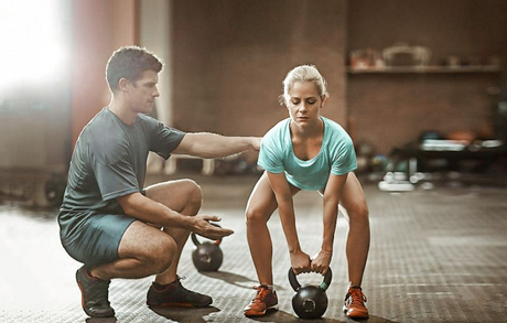 Women interval training with a kettlebell