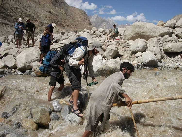 River crossing on K2 Base Camp trek in Pakistan