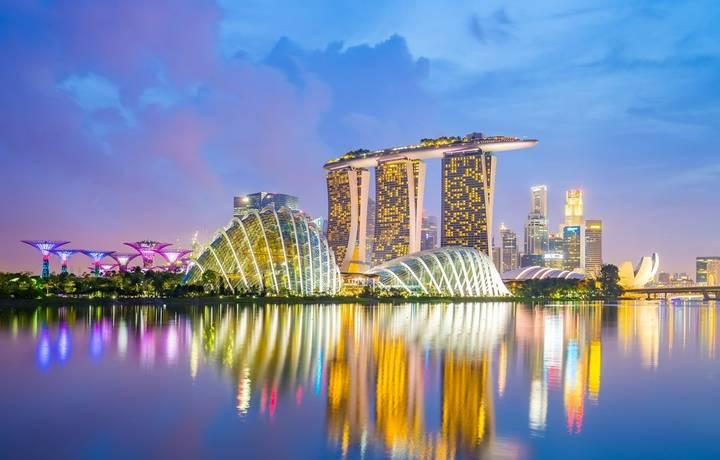 Singapore City, Singapore - July 17, 2015: Marina Bay skyline and view of Marina Bay at twilight. The Marina Bay is a bay ne…