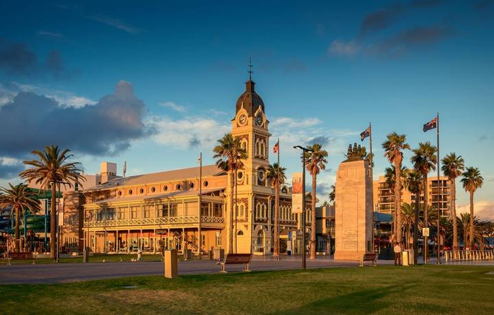 Adelaide, Australia - February 25, 2016: Glenelg Town Hall with Pioneer Memorial viewed through Moseley Square at sunset.