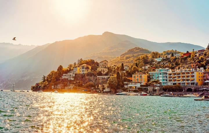 Sunset in the evening in Ascona luxury tourist resort promenade on Lake Maggiore in Ticino canton in Switzerland in summer. …