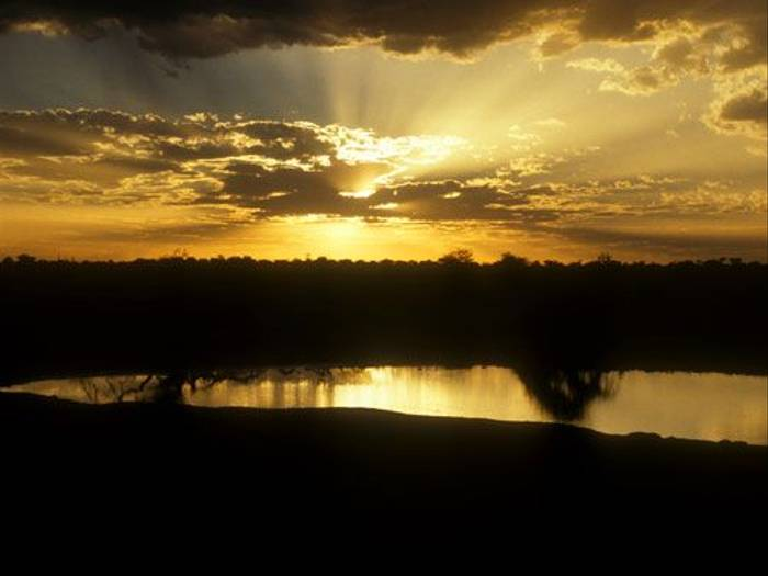 Sunset over an Etosha waterhole (Paul Stanbury)