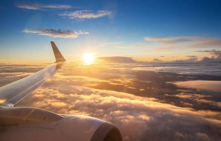 Sunset sky on airplane window over Copenhagen, Denmark, Scandinavia, Europe in Friday evening flight for relax in holiday