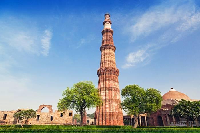 Qutub Minar Tower in New Delhi, India shutterstock_150596123.jpg