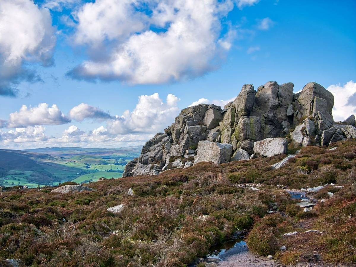 A rocky, millstone outcrop near Simon's Seat on Barden Fell in the Yorkshire Dales, England, UK - taken on a sunny day in Au…