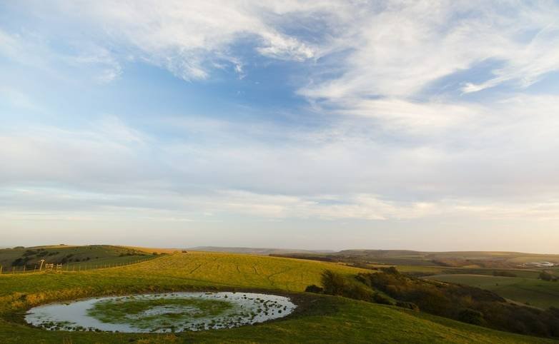 Ditchling Beacon, Sussex, UK. Small circular pond at Ditchling Beacon.