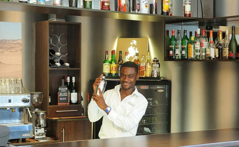 Namibia - Beach Hotel - Restaurant_Barman - Agent Photo.jpg