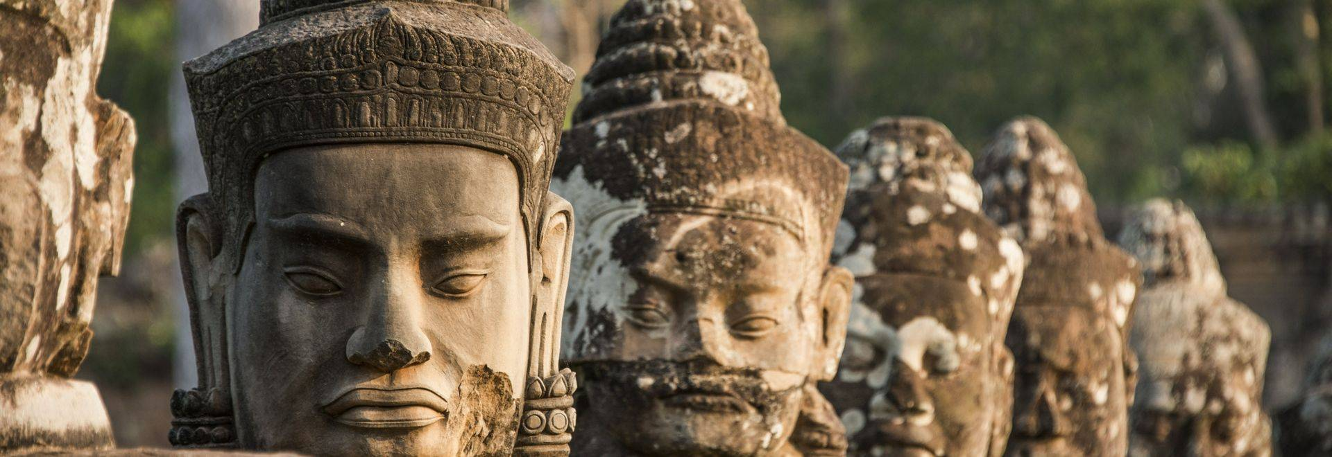 Carved figures on bridge to South Gate of Angkor Thom Temple in Angkor Archaeological Park, Cambodia.