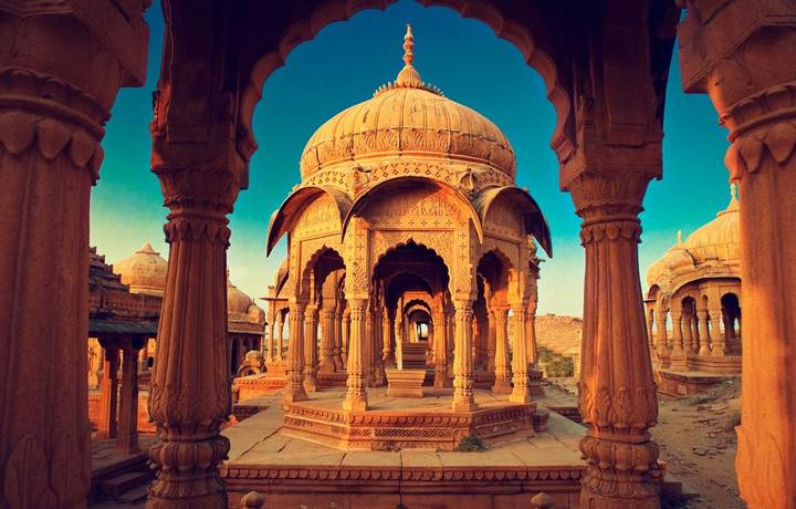 The royal cenotaphs, also known as Jaisalmer Chhatris, at Bada Bagh in Jaisalmer. Made of yellow sandstone at sunset
