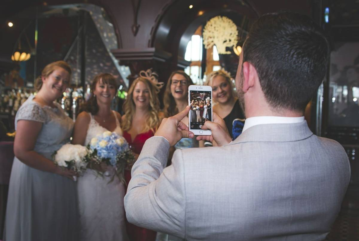 Capturing bride on phone screen