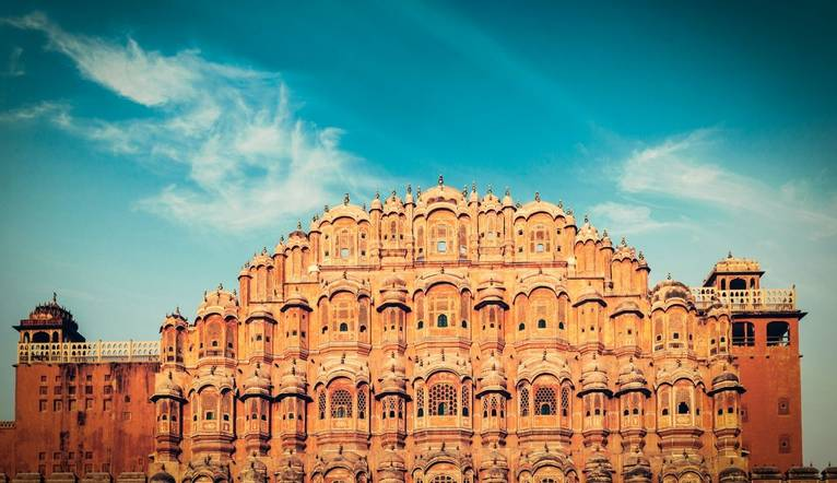 Vintage retro hipster style travel image of Famous Rajasthan landmark - Hawa Mahal palace (Palace of the Winds), Jaipur, Raj…