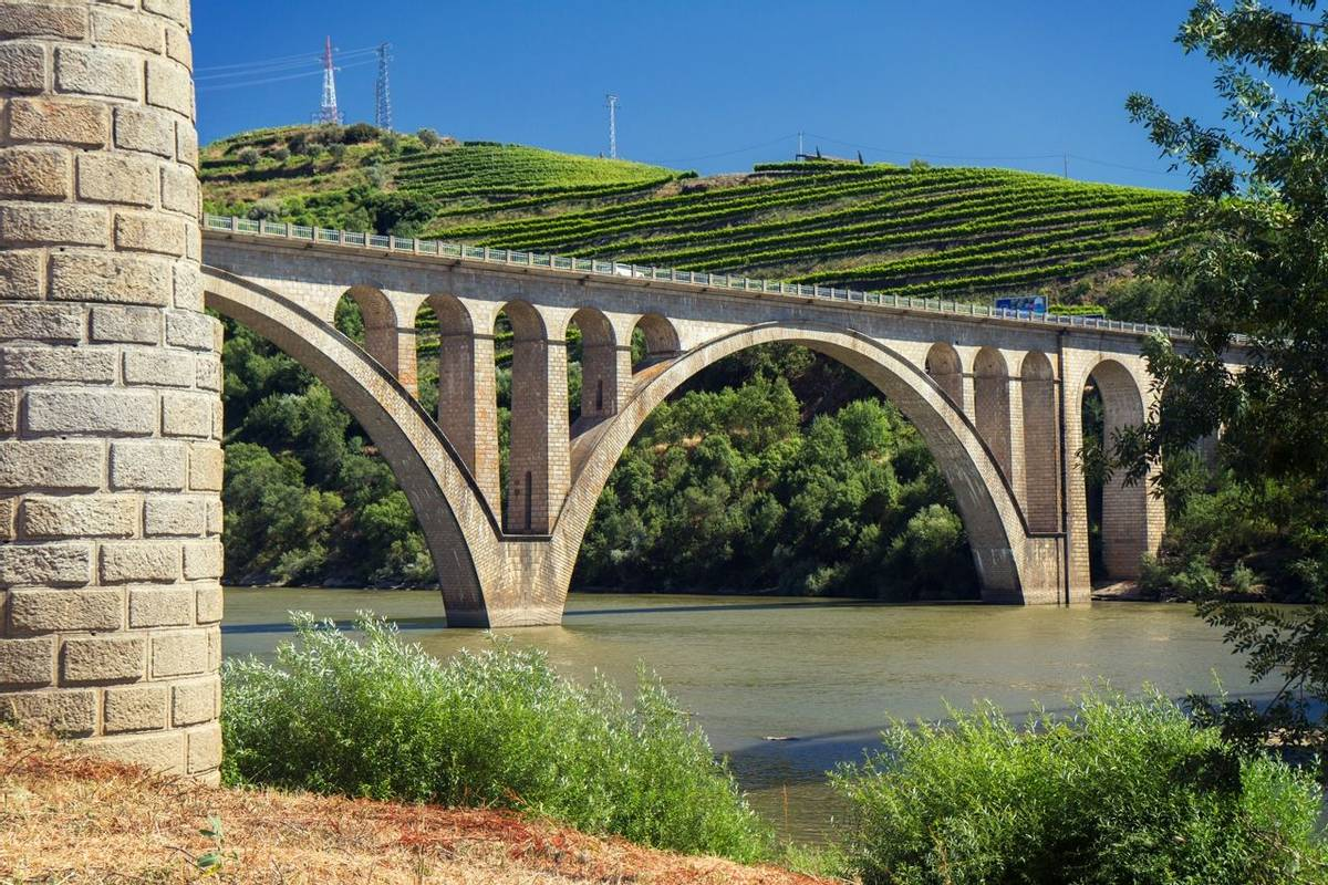 bridge in river Douro in portuguese city Peso da Regua