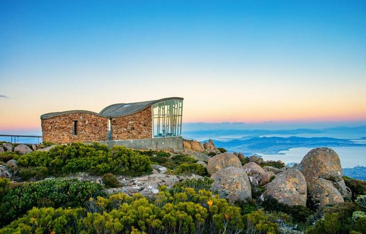 The view at Mount Wellington at sunset in Hobart, Tasmania, Australia.  Mount Wellington is a popular location to watch suns…