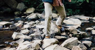 Hiking across a stream