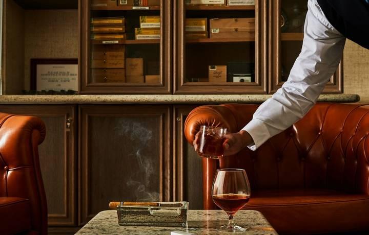 Serving cognac in the Connoisseur's Corner.