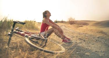 Woman resting from bike ride.