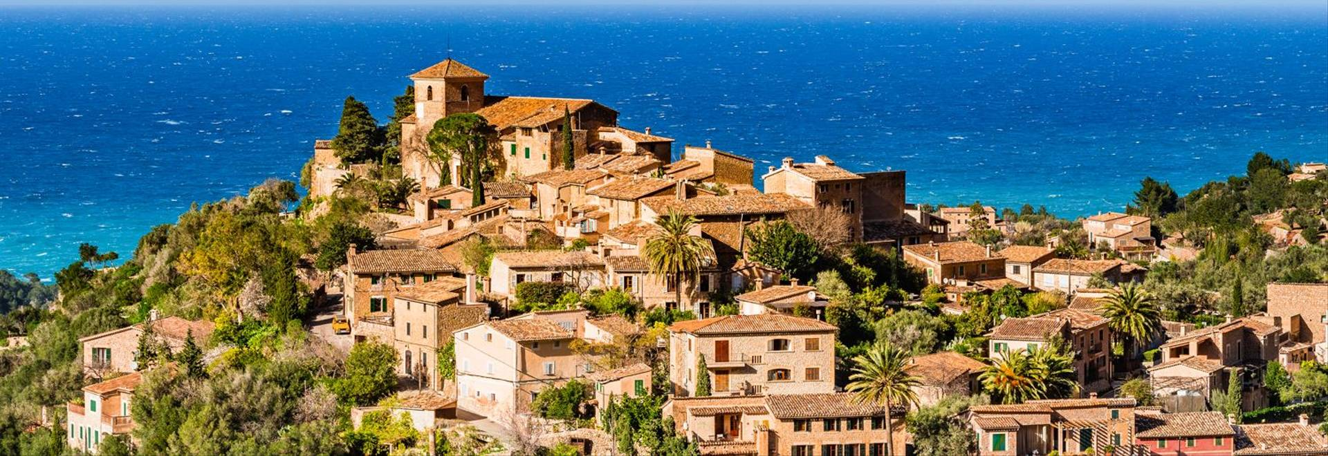 Old mediterranean village Deia at the coast in the mountains of Majorca island, Mediterranean Sea Spain