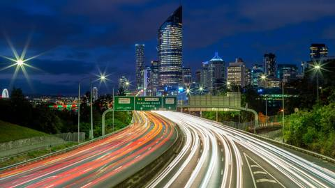 night scene of brisbane with traffic trails