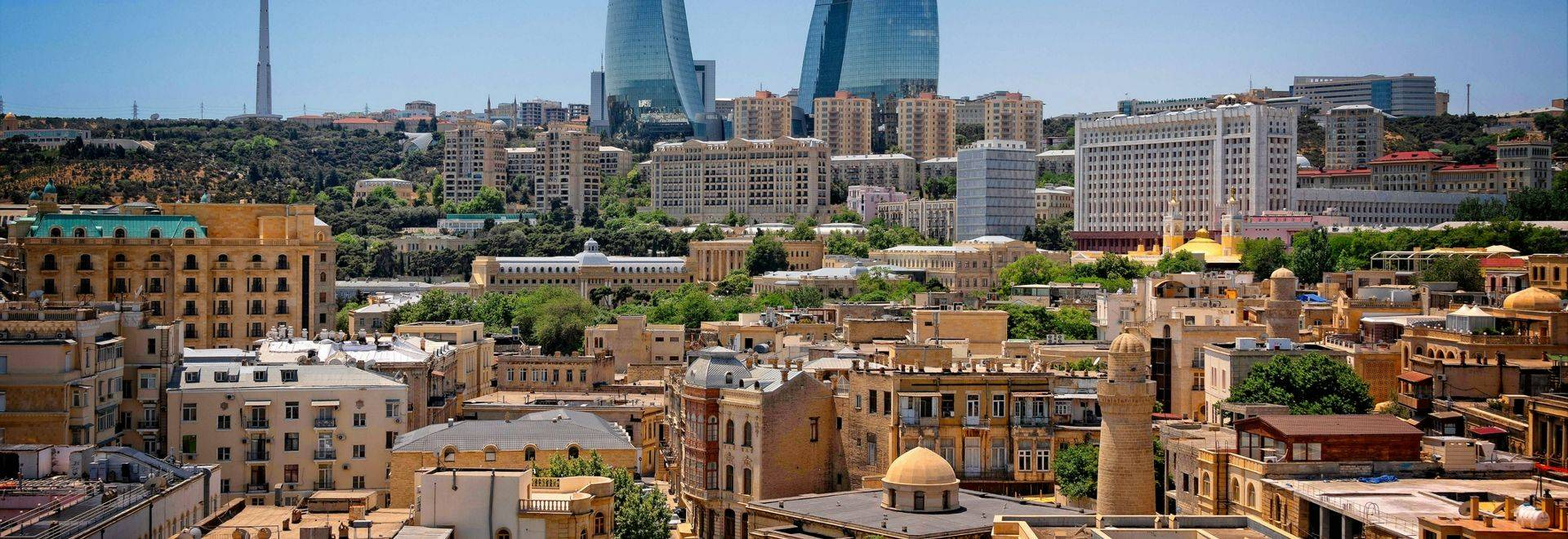GettyImages 986764046 Baku Old Town With Flame Towers In The Background, Azerbaijan