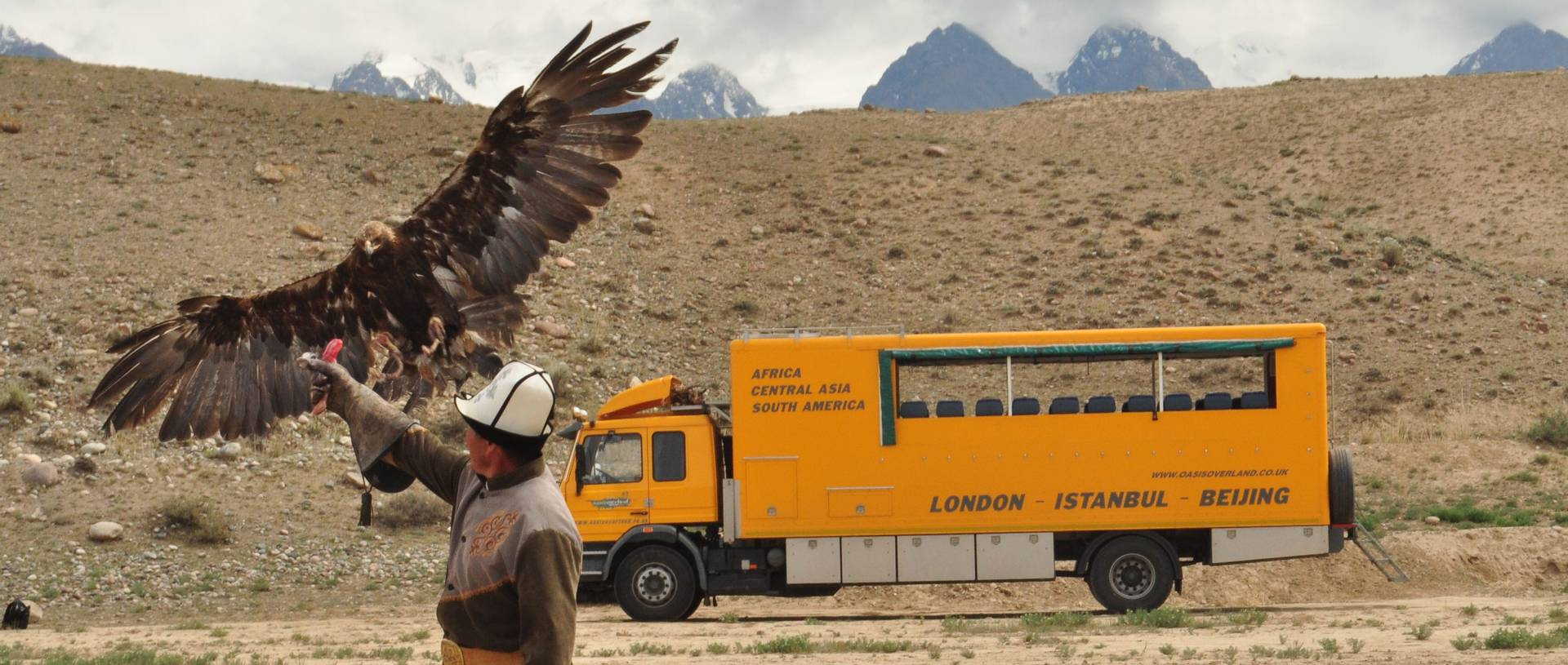 Hunting Display With An Eagle and Oasis truck, Kyrgyzstan