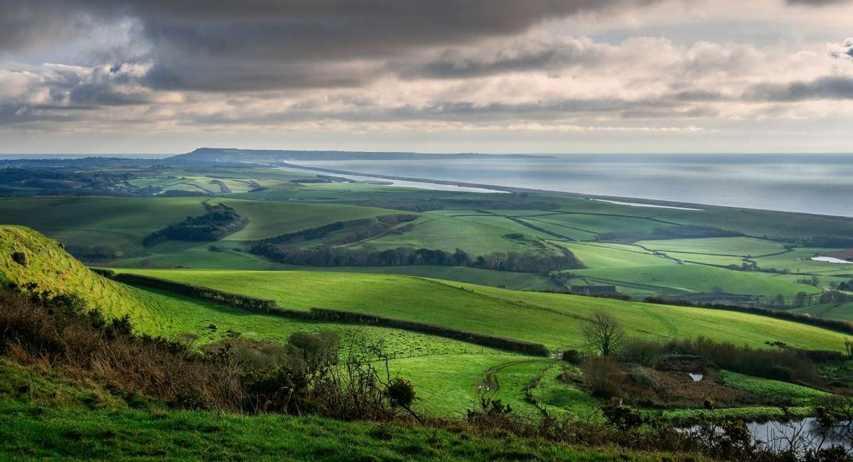 Panoramic view of Portand and Chesil Beach from the hill tops near Abbotsbury in Dorset, UK