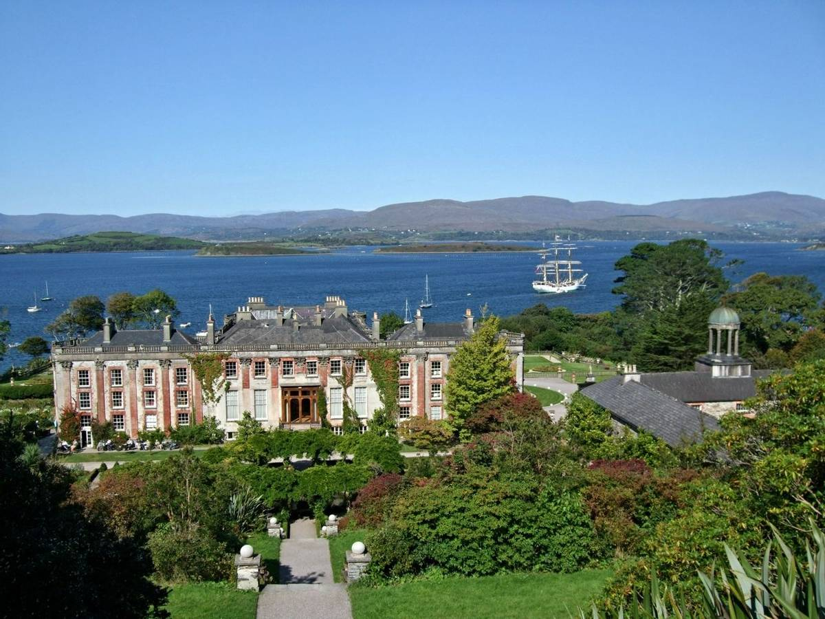 Bantry House in Ireland with sailboat in behind