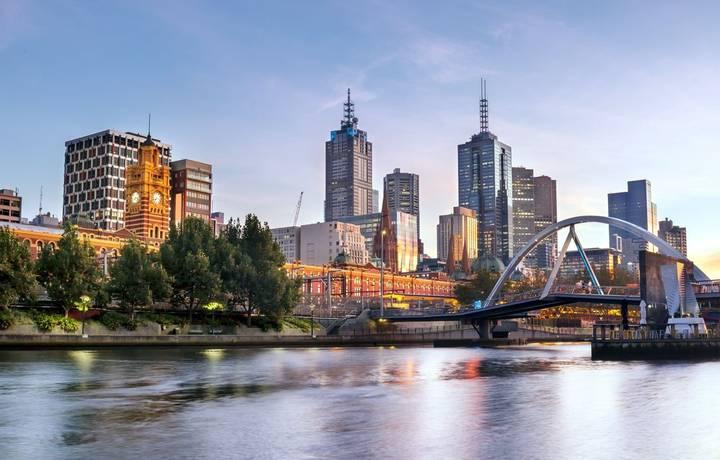Melbourne, Australia, in early morning light.  Yarra River, towards Flinders Street Station.